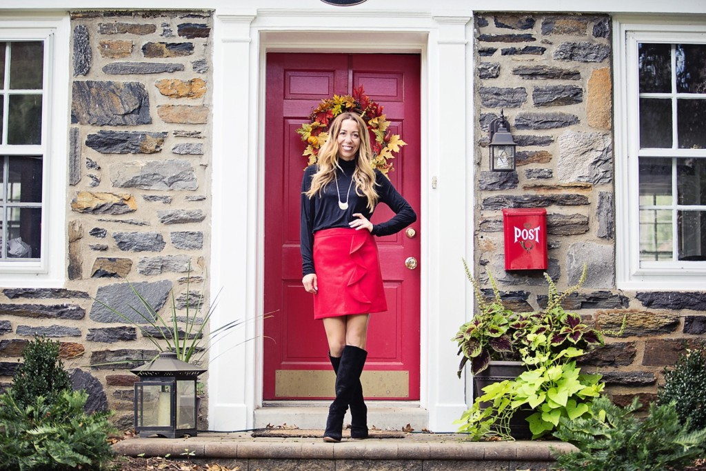 The Motherchic wearing red wool mini skirt from J.Crew