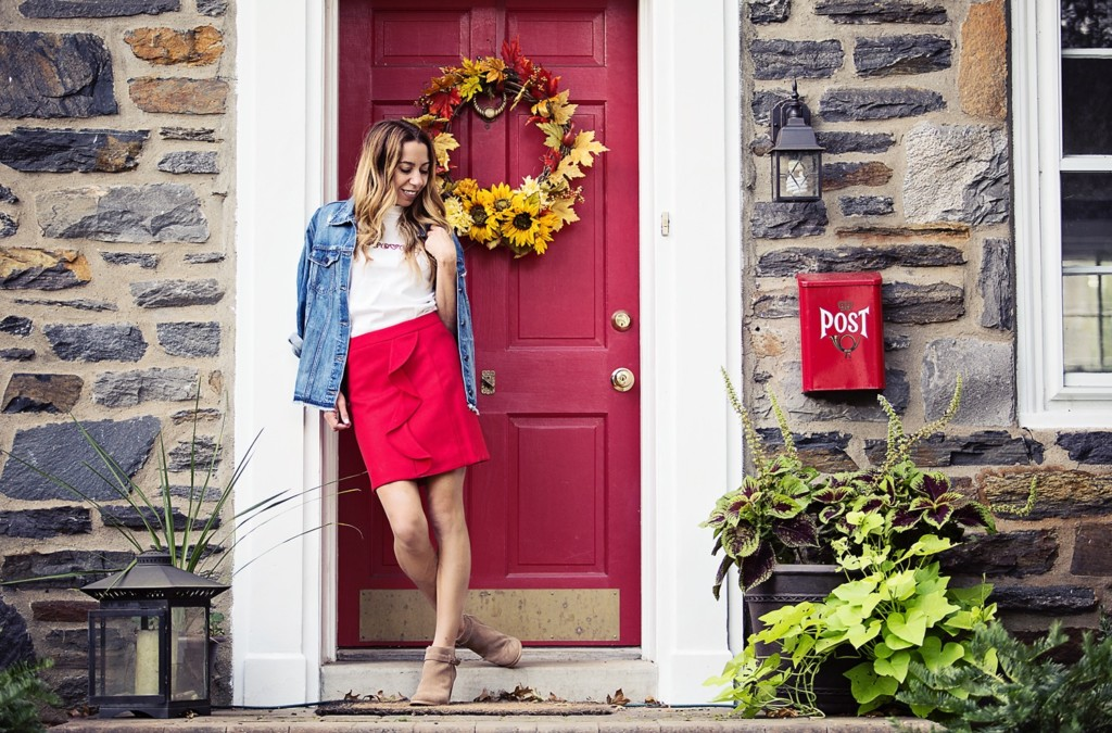 The Motherchic wearing red wool skirt