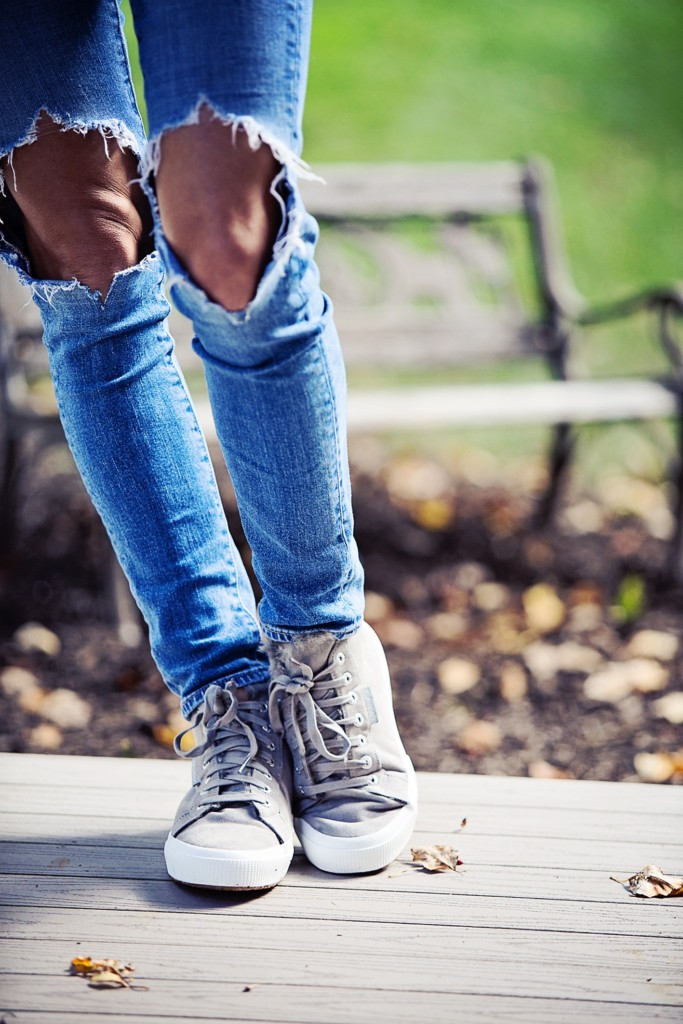 The Motherchic wearing Levi's high waisted jeans from Shopbop and Superga high tops