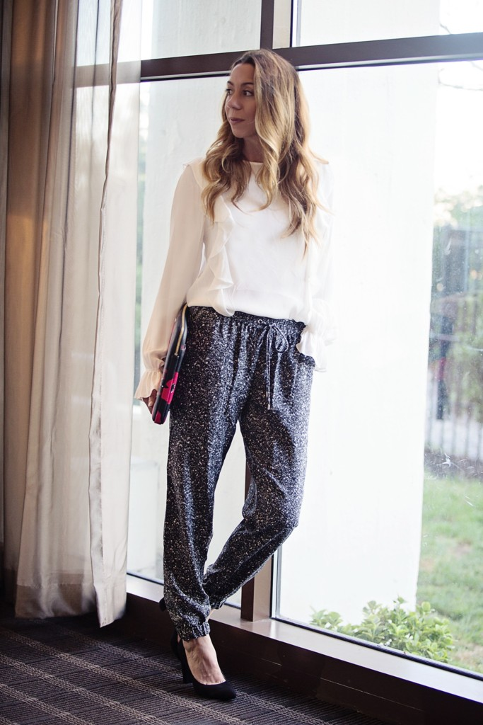 The Motherchic wearing ruffle blouse and joggers from Macy's