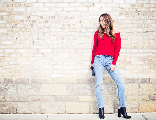 The Motherchic wearing red everlane cashmere sweater and levi's jeans