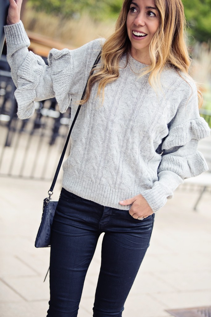 The Motherchic wearing Wayf ruffle sleeve sweater from Shopbop and Blank NYC jeans