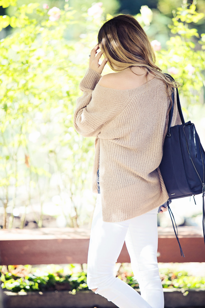 The Motherchic wearing Rebecca Minkoff sweater with white denim and black tote