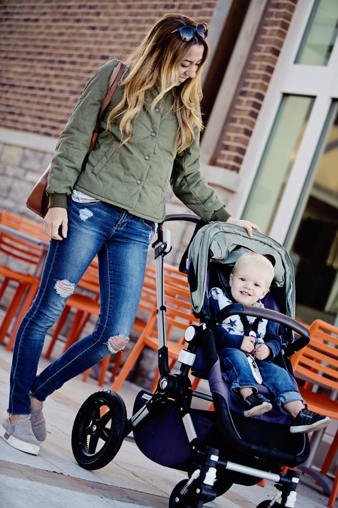 The Motherchic wearing quilted military jacket by madewell and bugaboo stroller