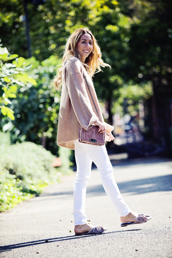 The Motherchic wearing Rebecca Minkoff sweater with white denim and velvet mules