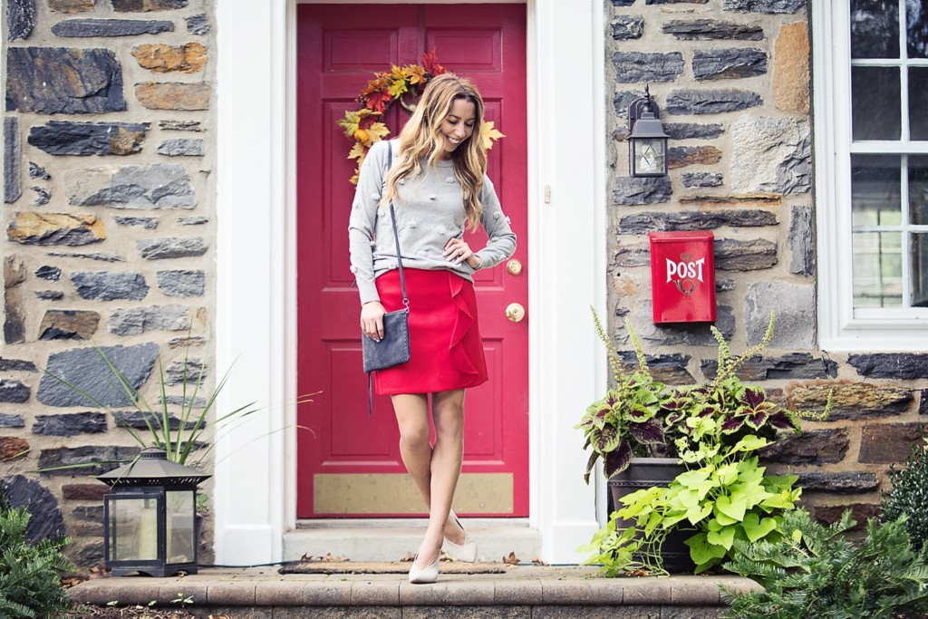 The Motherchic wearing J.Crew ruffle mini skirt