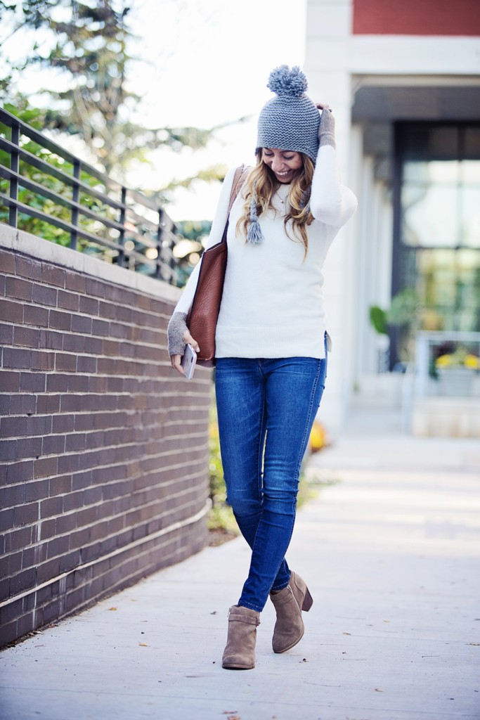 The motherchic wearing madewell high rise skinny jeans and thumbhole sweater