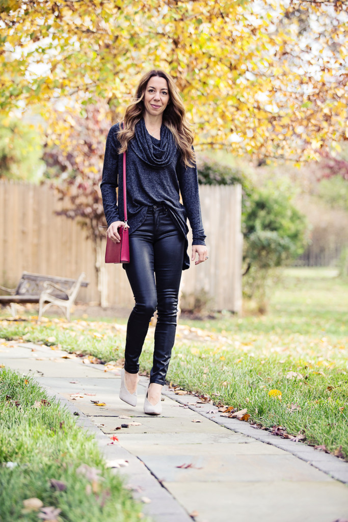 The Motherchic wearing cowl neck sweater and black coated jeans