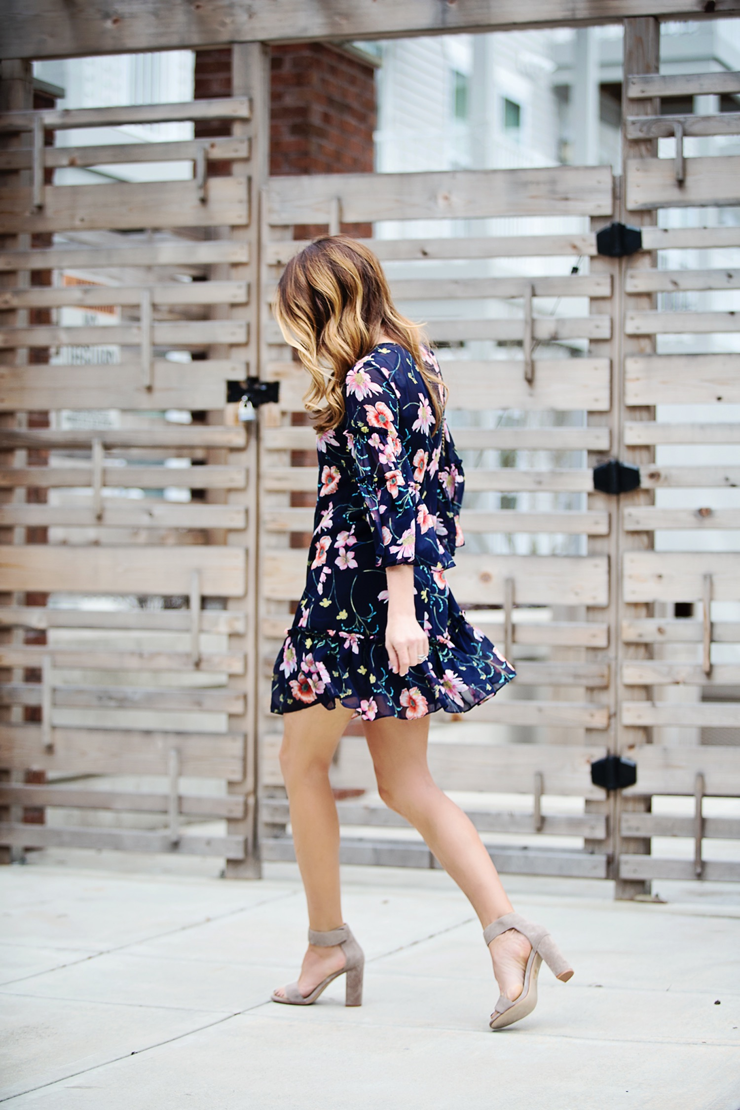 The Motherchic wearing Chelsea28 bell sleeve floral dress from Nordstrom