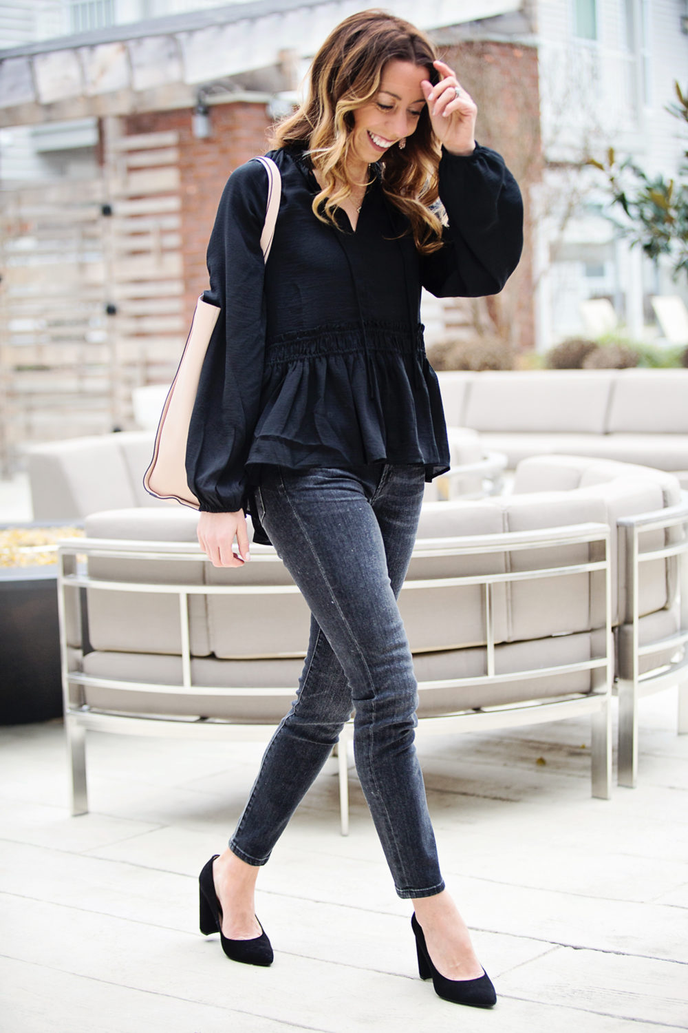The Motherchic wearing black smocked loft top
