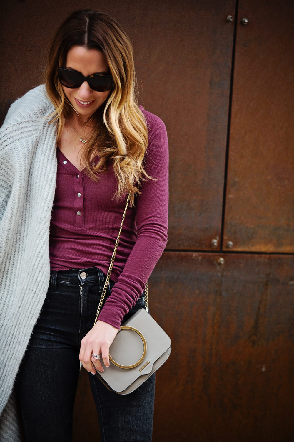 The Motherchic wearing urban outfitters henley and cardigan