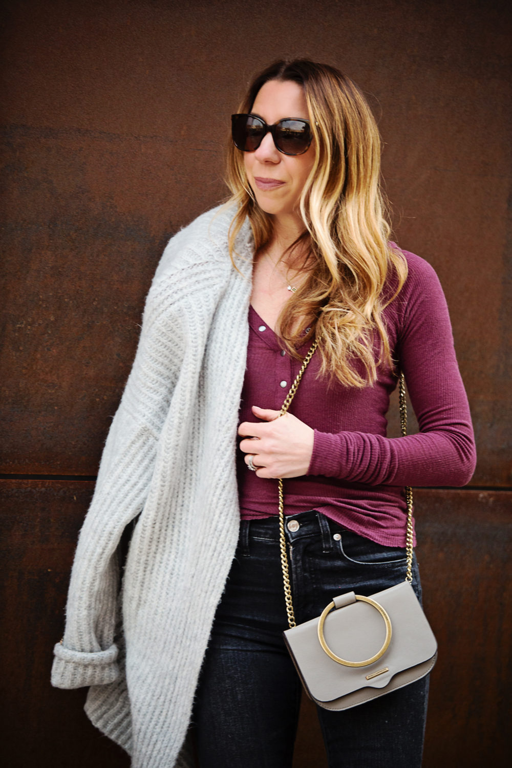 The Motherchic wearing urban outfitters henley and j.crew cardigan