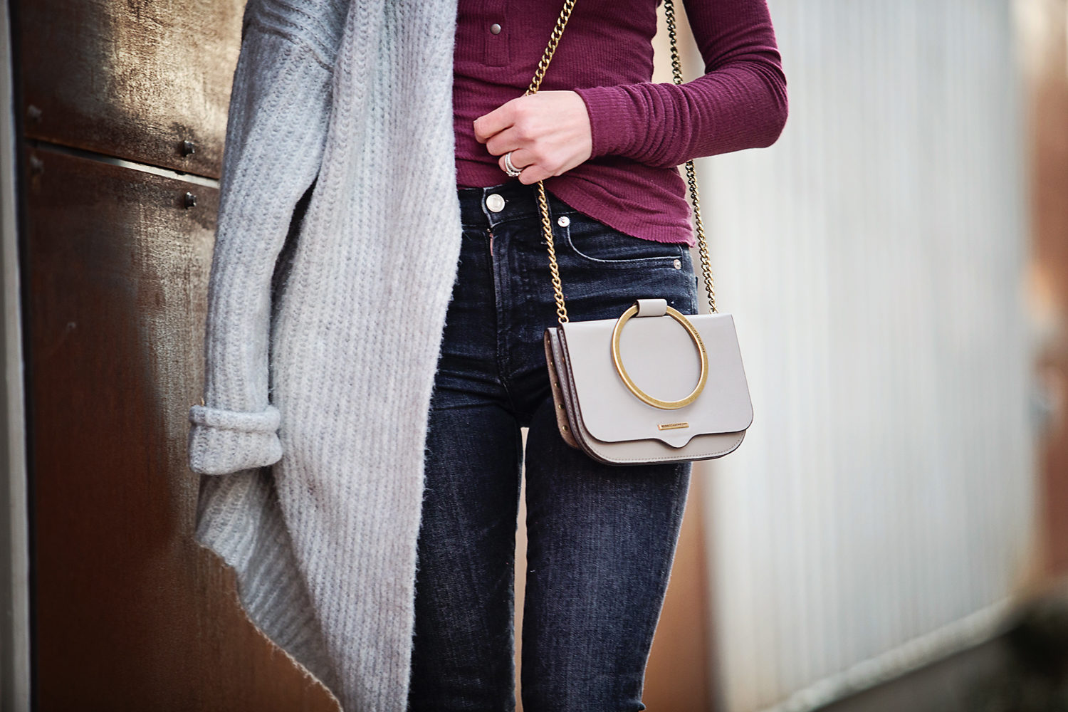 The motherchic wearing rebecca minkoff crossbody bag