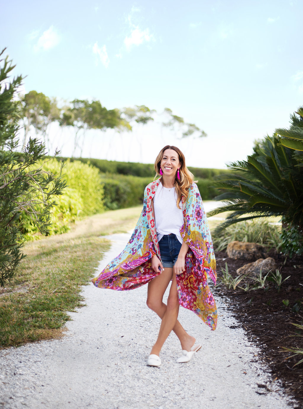 The Motherchic wearing free people kimono and madewell jean shorts