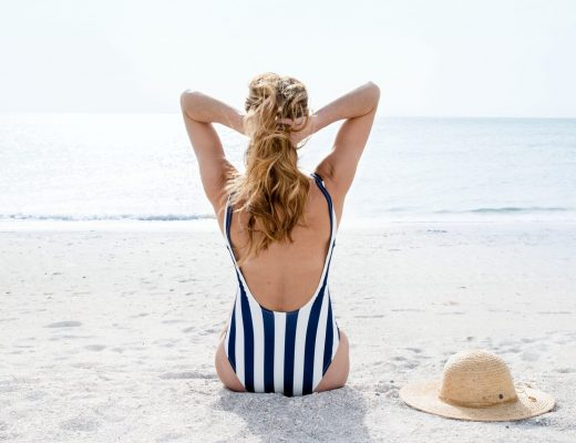 The motherchic wearing one piece bathing suit