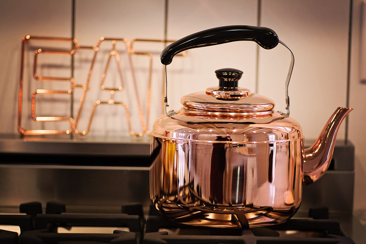 The Motherchic kitchen with copper kettle and eat sign