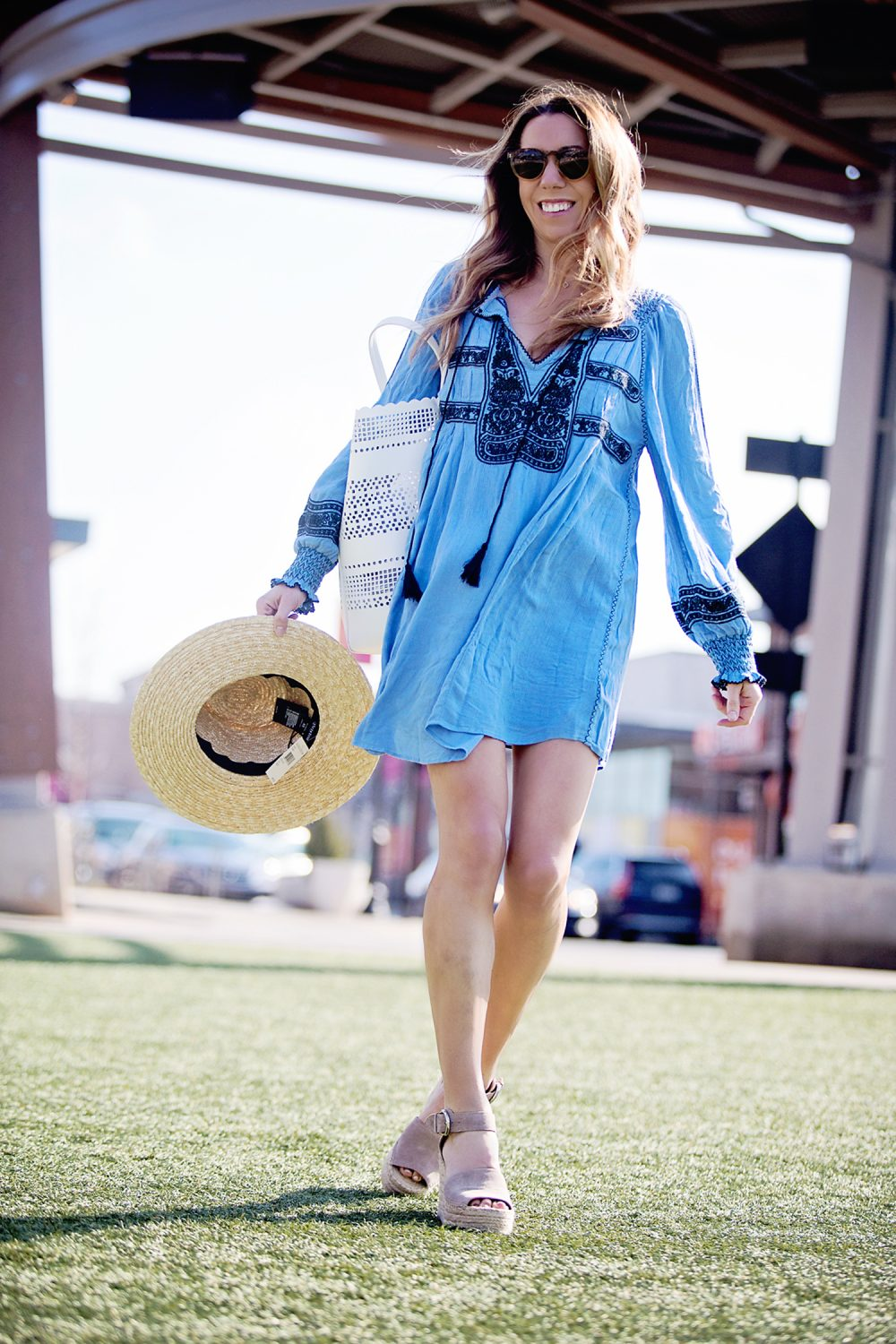 The Motherchic wearing free people wind willow mini dress
