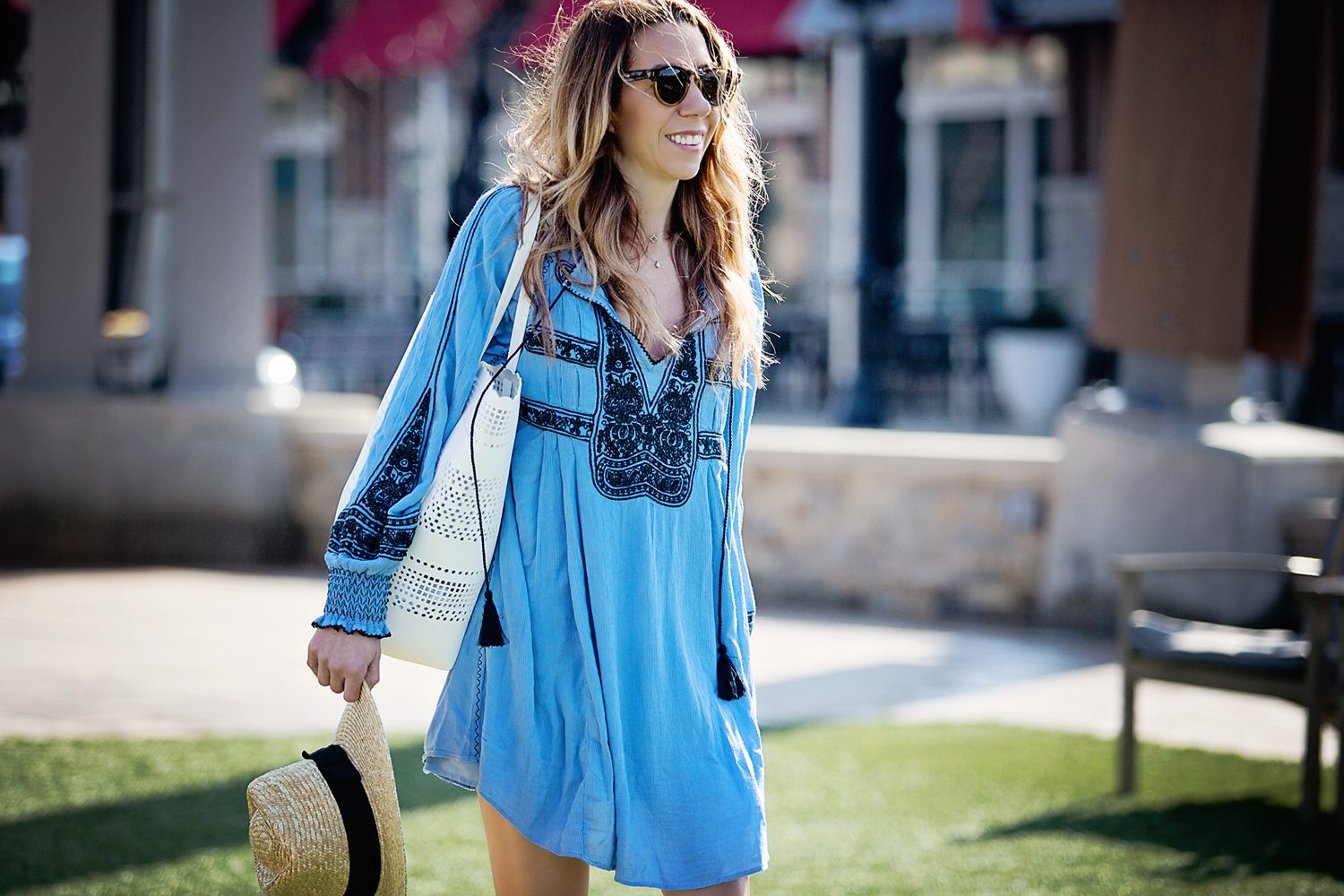 The Motherchic wearing free people mini dress