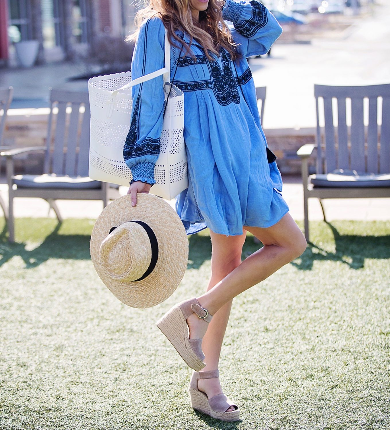 The Motherchic wearing free people dress