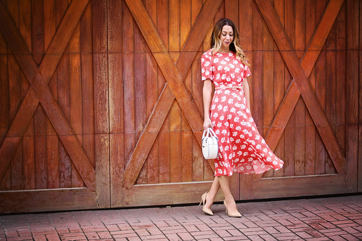 The Motherchic wearing a floral midi dress from Boden