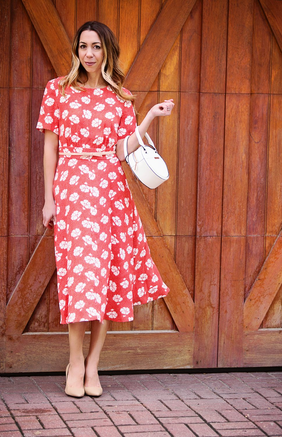 The Motherchic wearing a floral dress from Boden