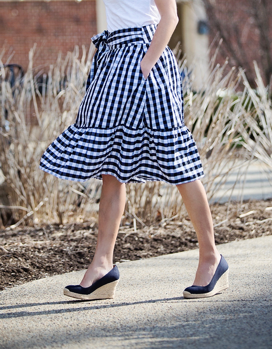 The Motherchic wearing gingham skirt and espadrille wedges from J.Crew Factory