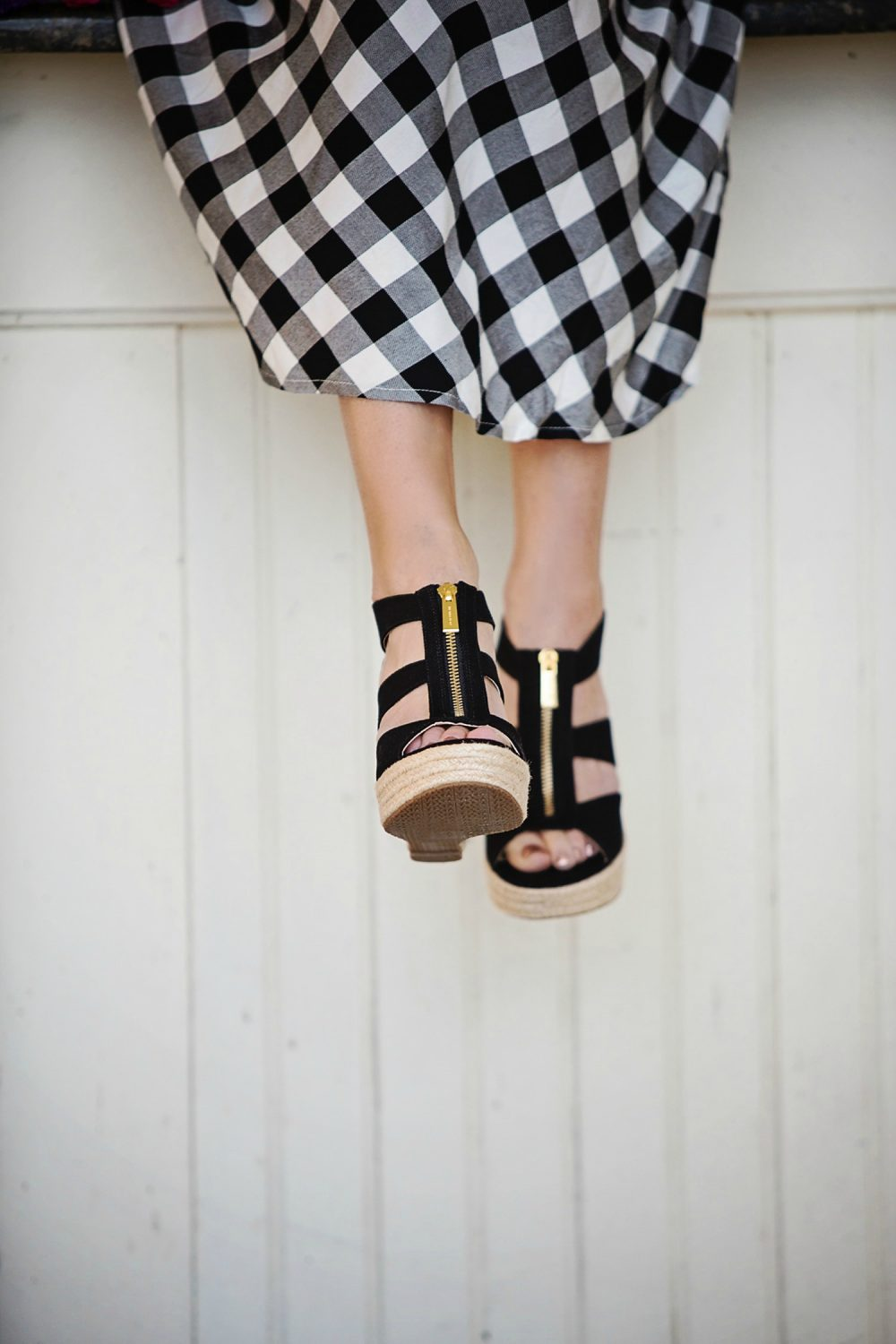 The Motherchic wearing Michael Kors wedges and gingham dress