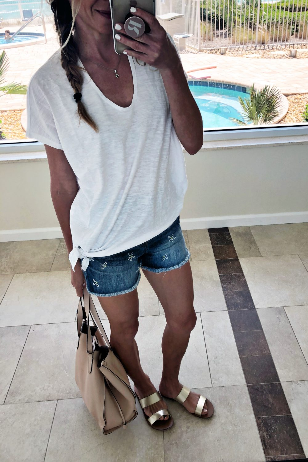 The Motherchic wearing madewell embroidered shorts