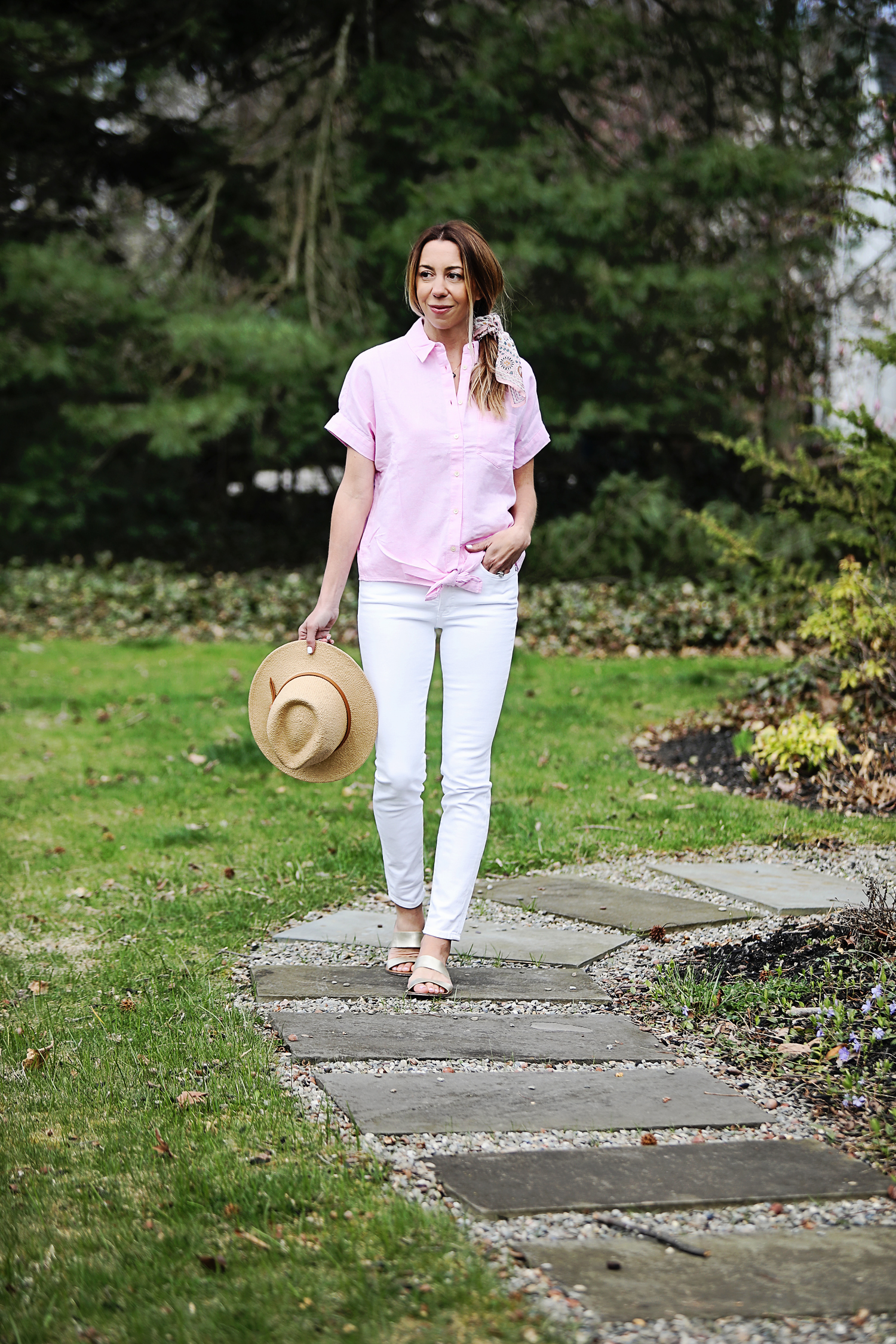 The Motherchic wearing white denim by Madewell