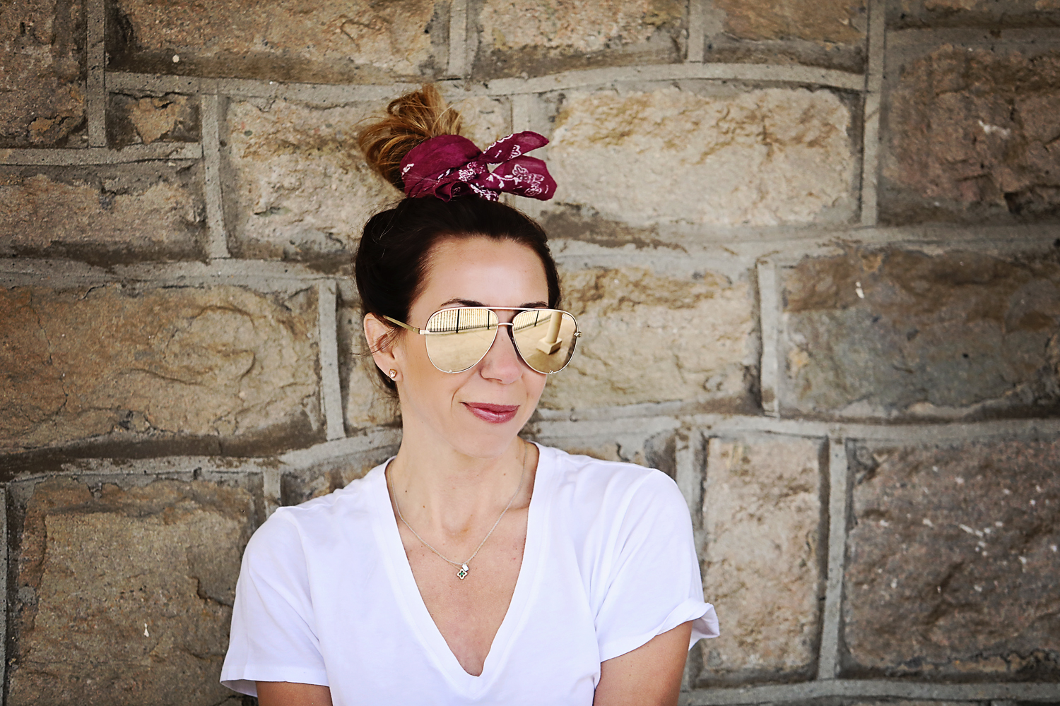 The Motherchic wearing Quay sunglasses