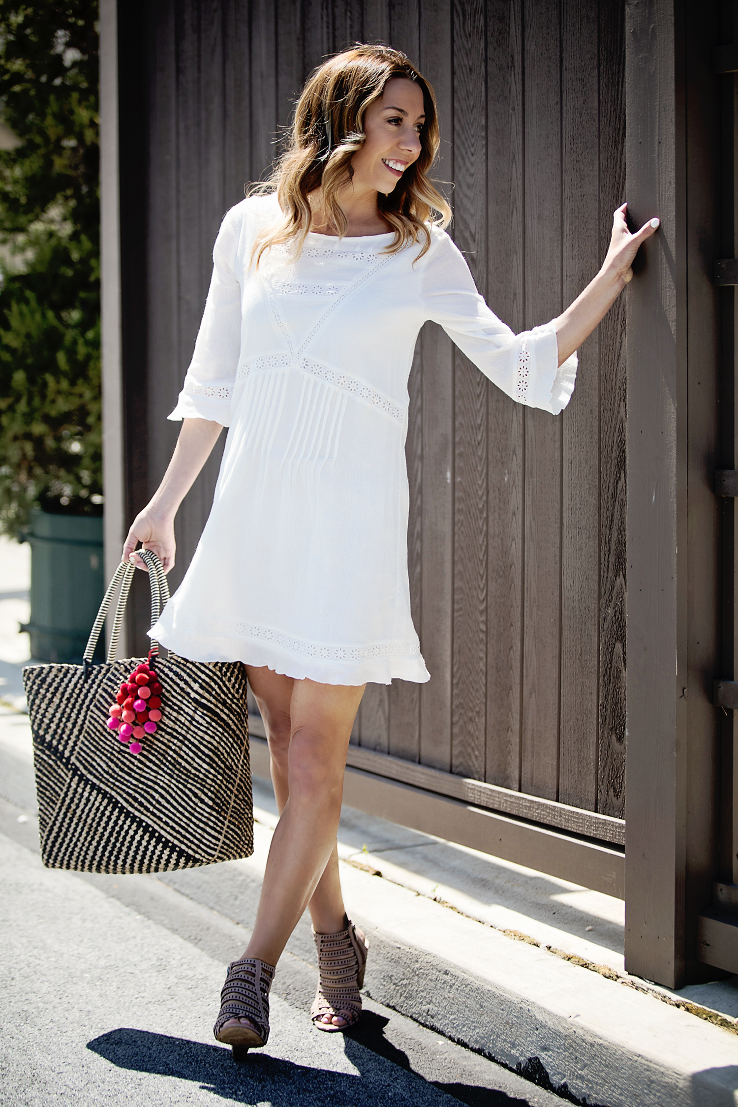 The Motherchic wearing white dress from macy's friends and family sale