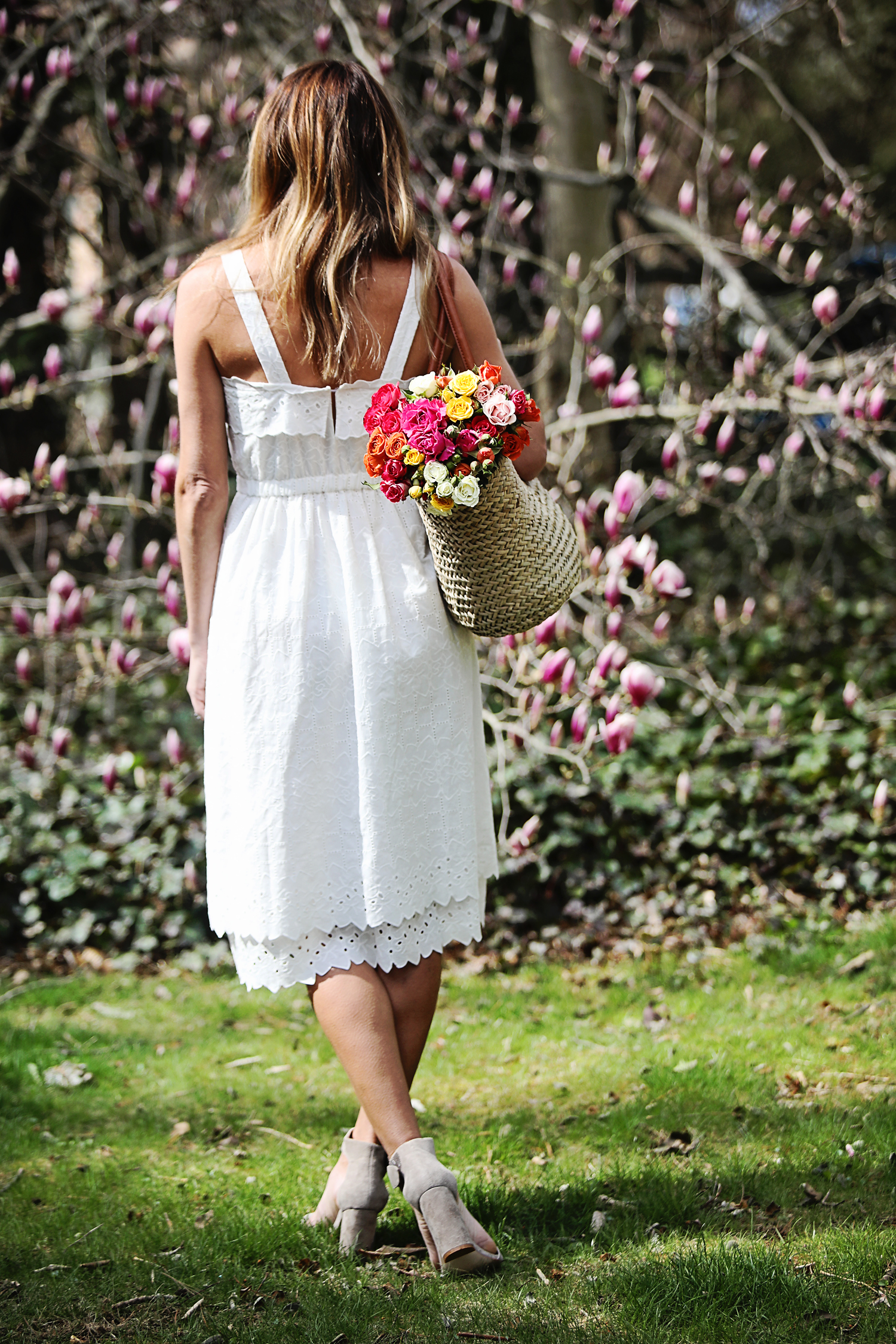 The Motherchic wearing white dress