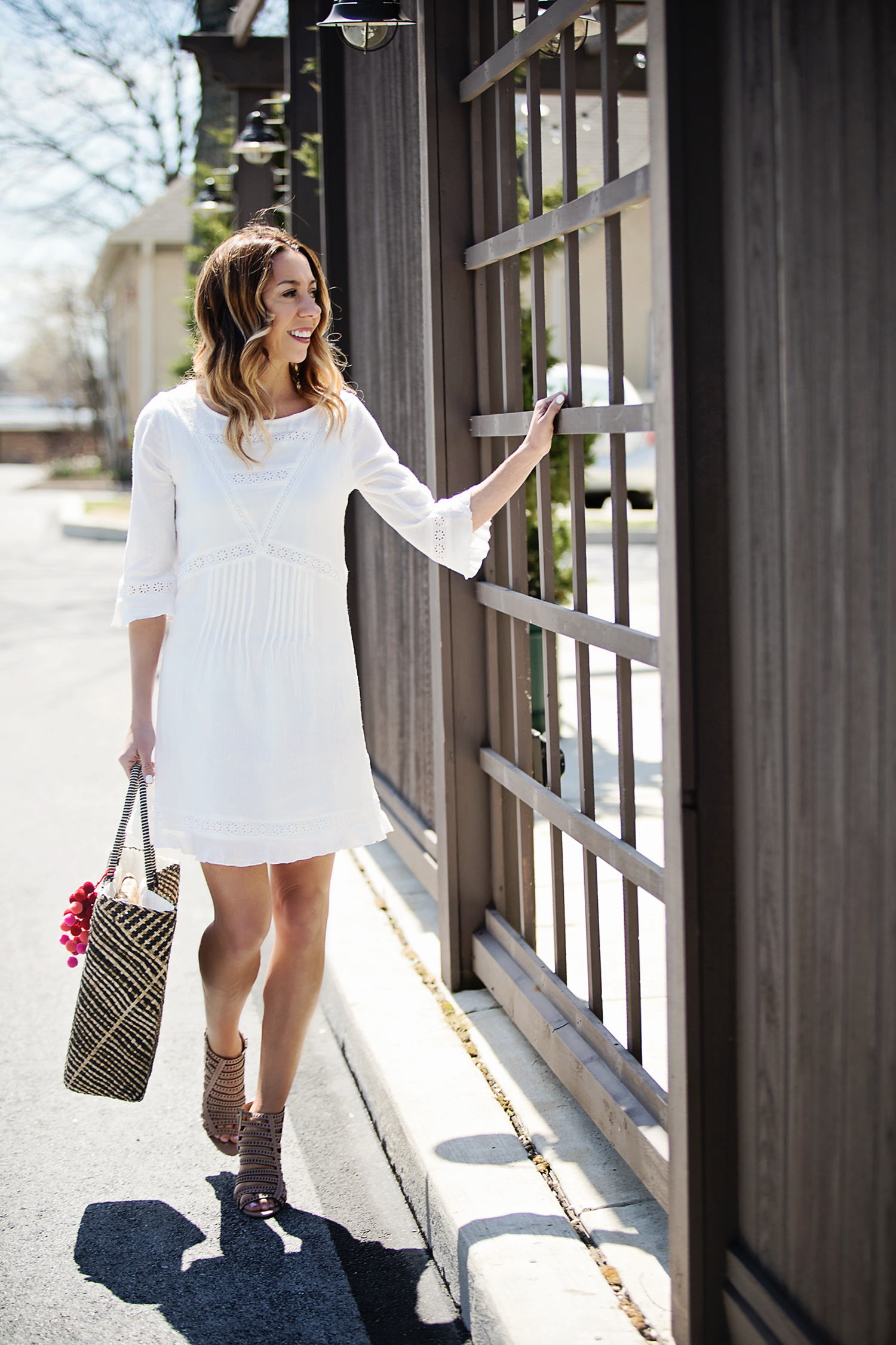The Motherchic wearing sanctuary white dress from Macy's Friends and Family Sale