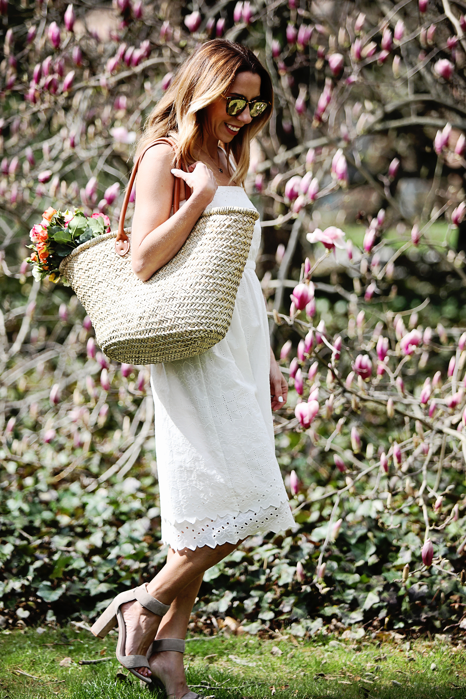The Motherchic wearing white dress from madewell