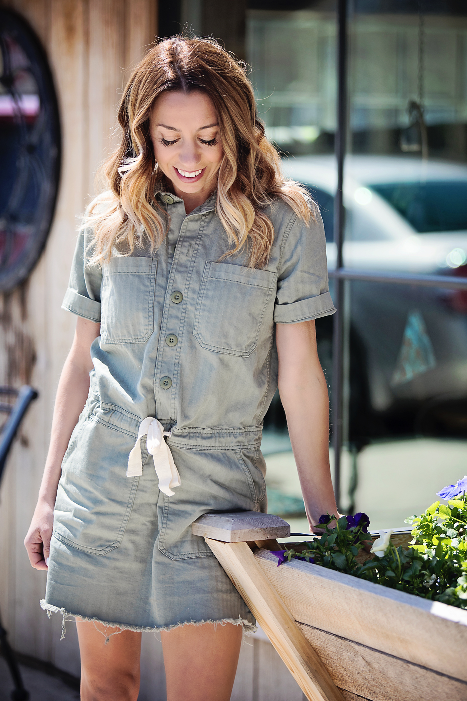The Motherchic wearing utility dress by lucky brand