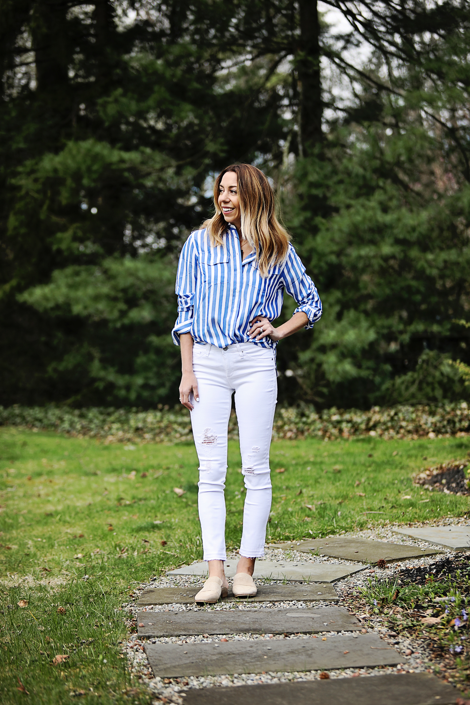 The Motherchic wearing AG raw hem jeans