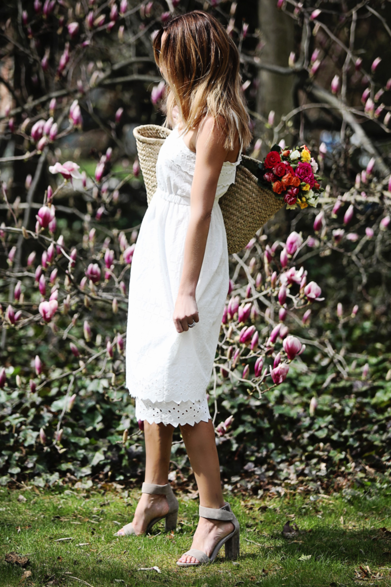 The Motherchic wearing madewell white dress