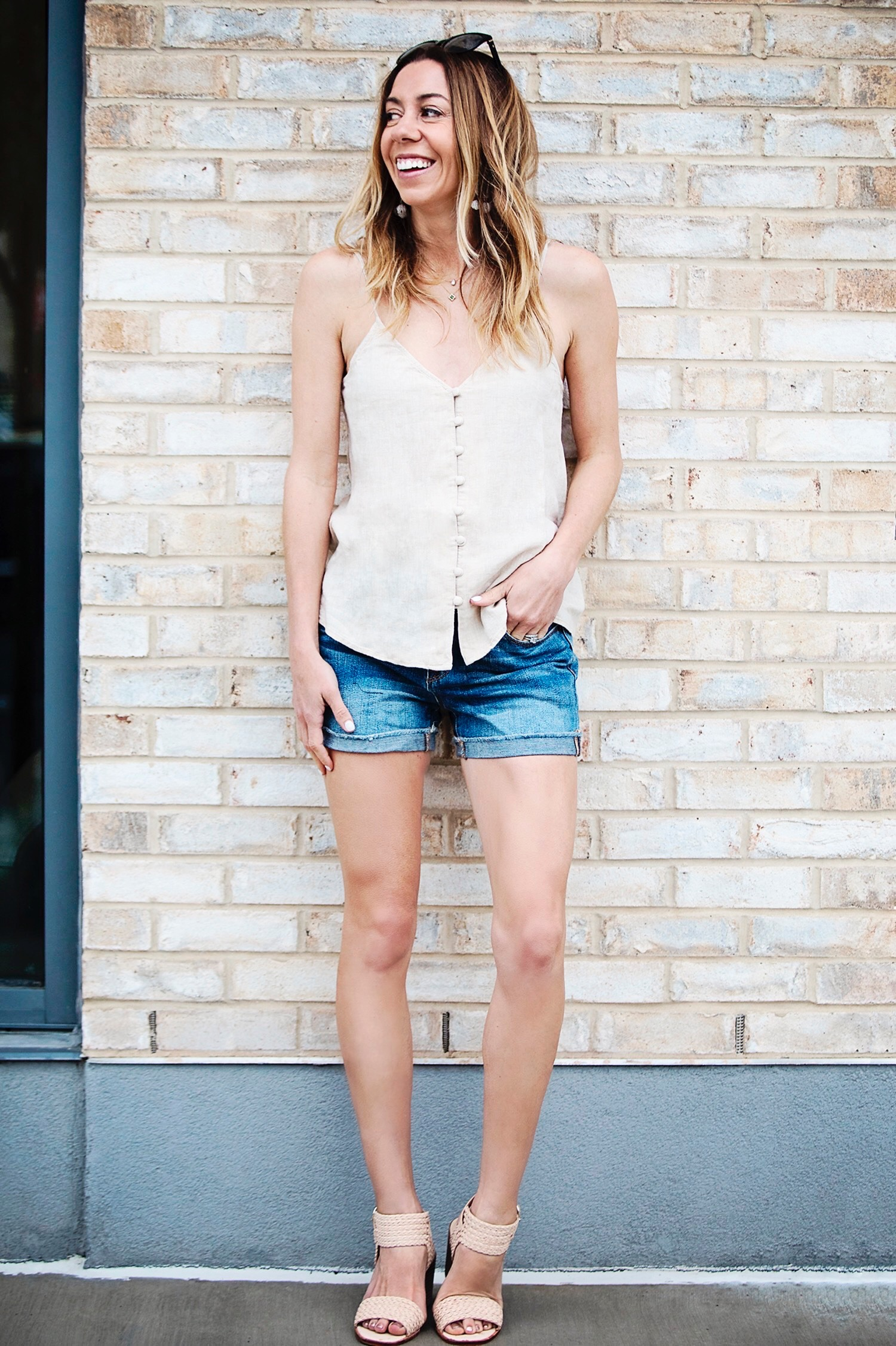 The Motherchic wearing buttoned cami