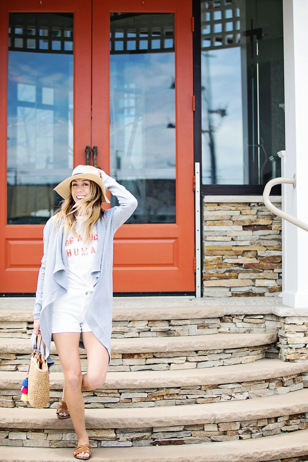 The Motherchic wearing J.Crew white shorts and graphic tee
