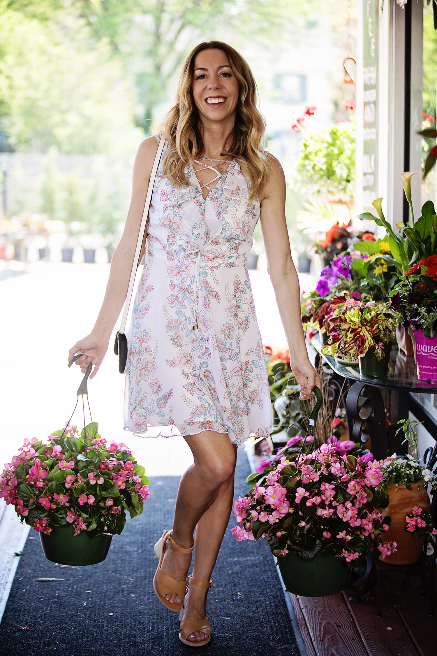 The Motherchic wearing floral dress from Lord & Taylor