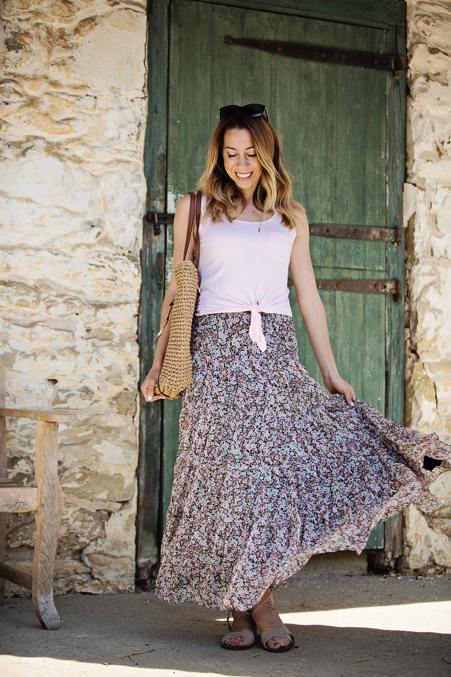 The Motherchic wearing floral maxi skirt