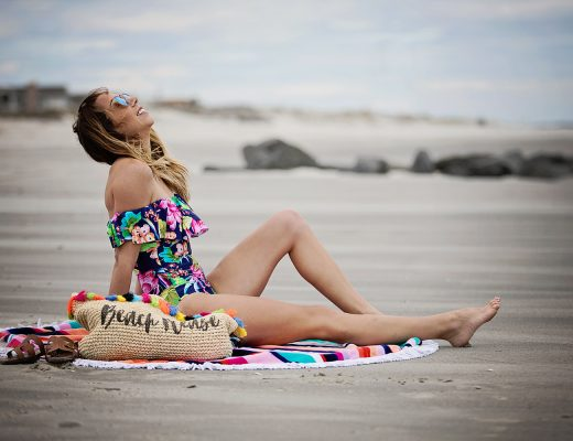 The Motherchic wearing la blanca swimsuit