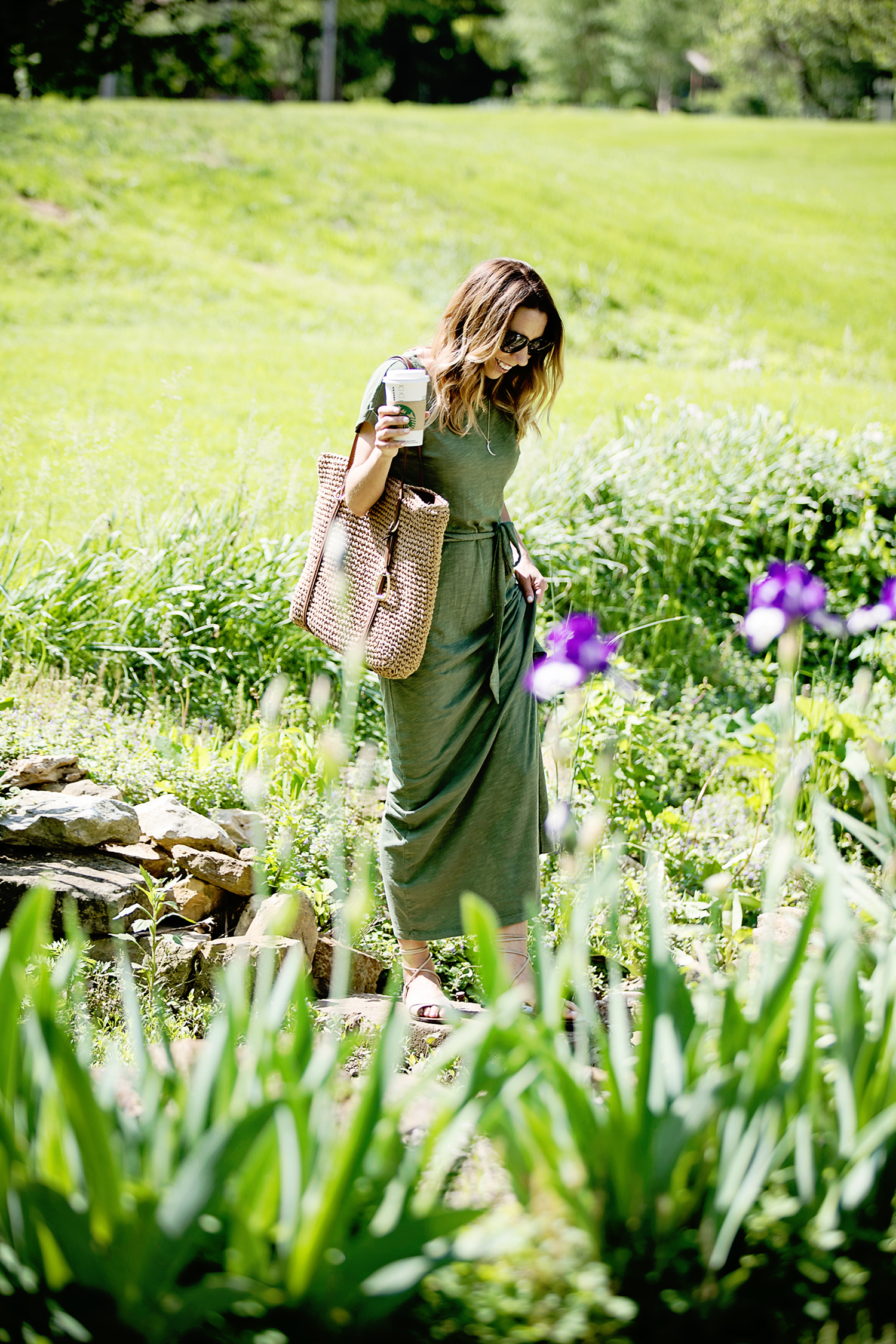 The Motherchic wearing sanctuary maxi dress from macy's