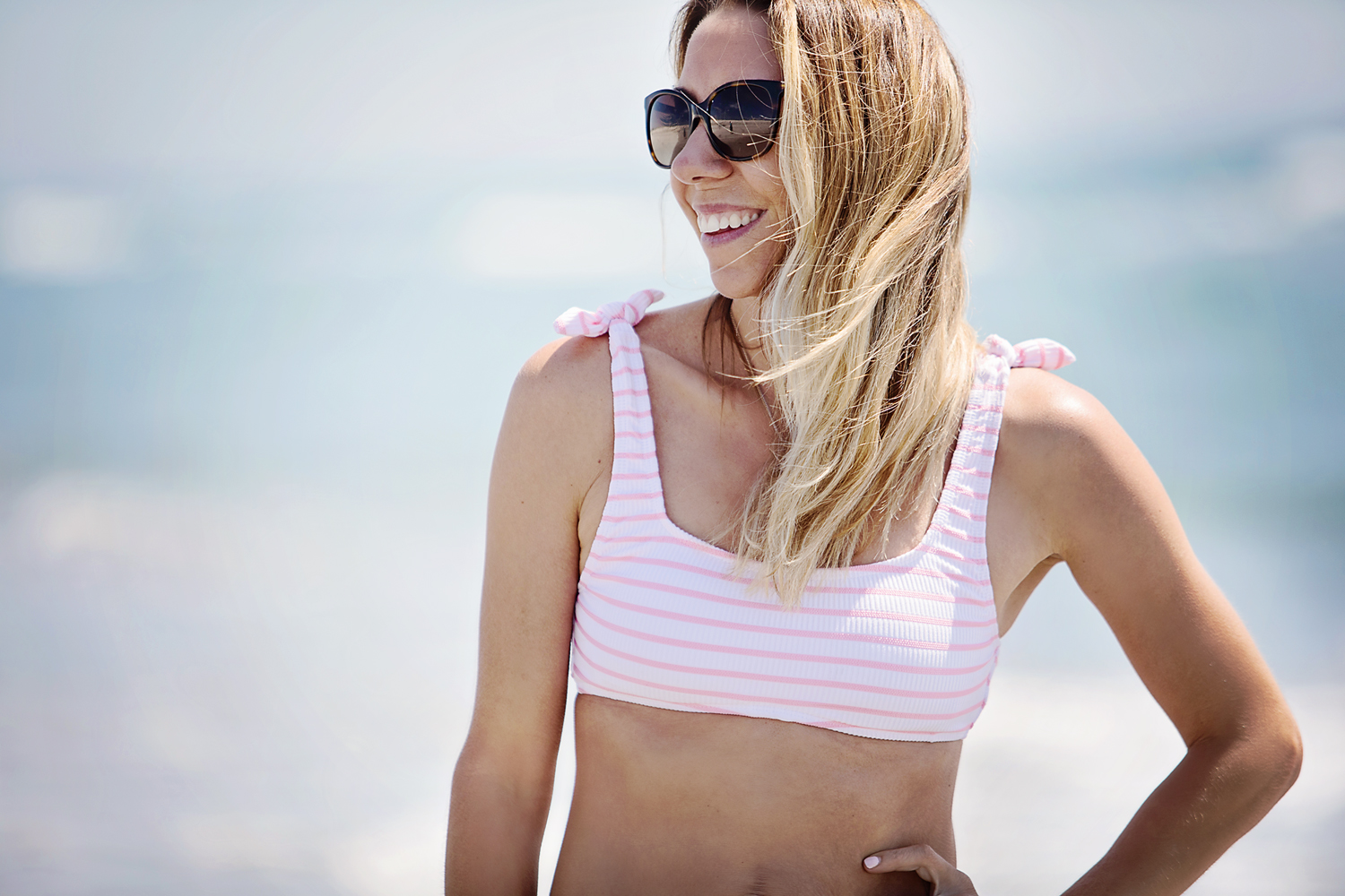 The Motherchic wearing summer stripes bikini