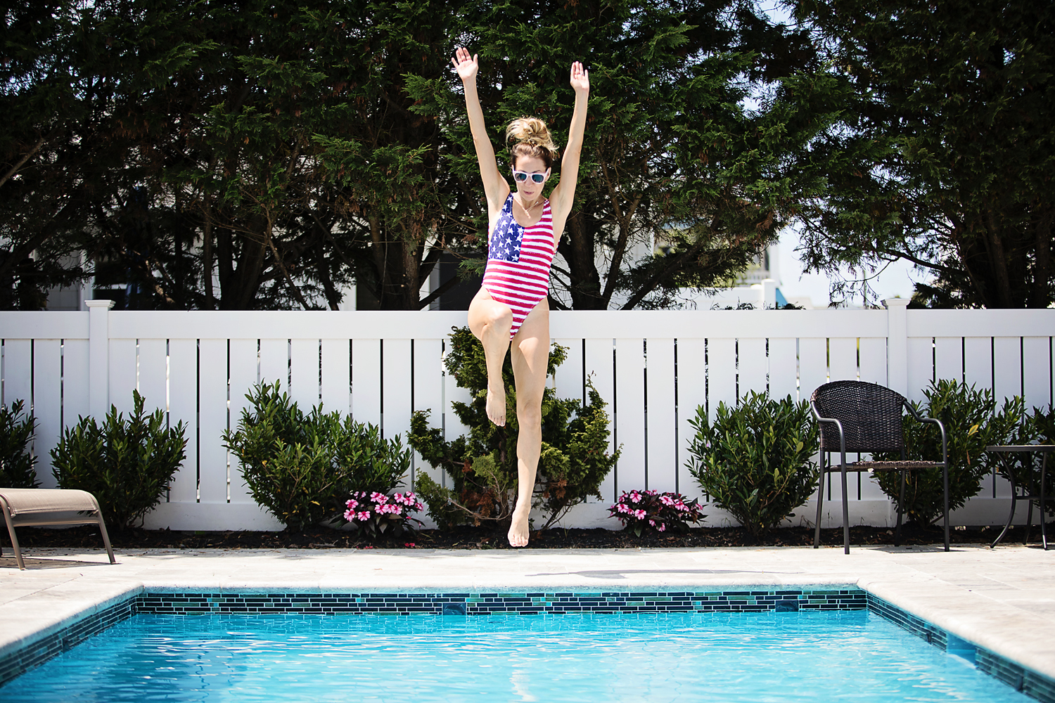 The Motherchic wearing alternative apparel sweatshirt and american flag bathing suit