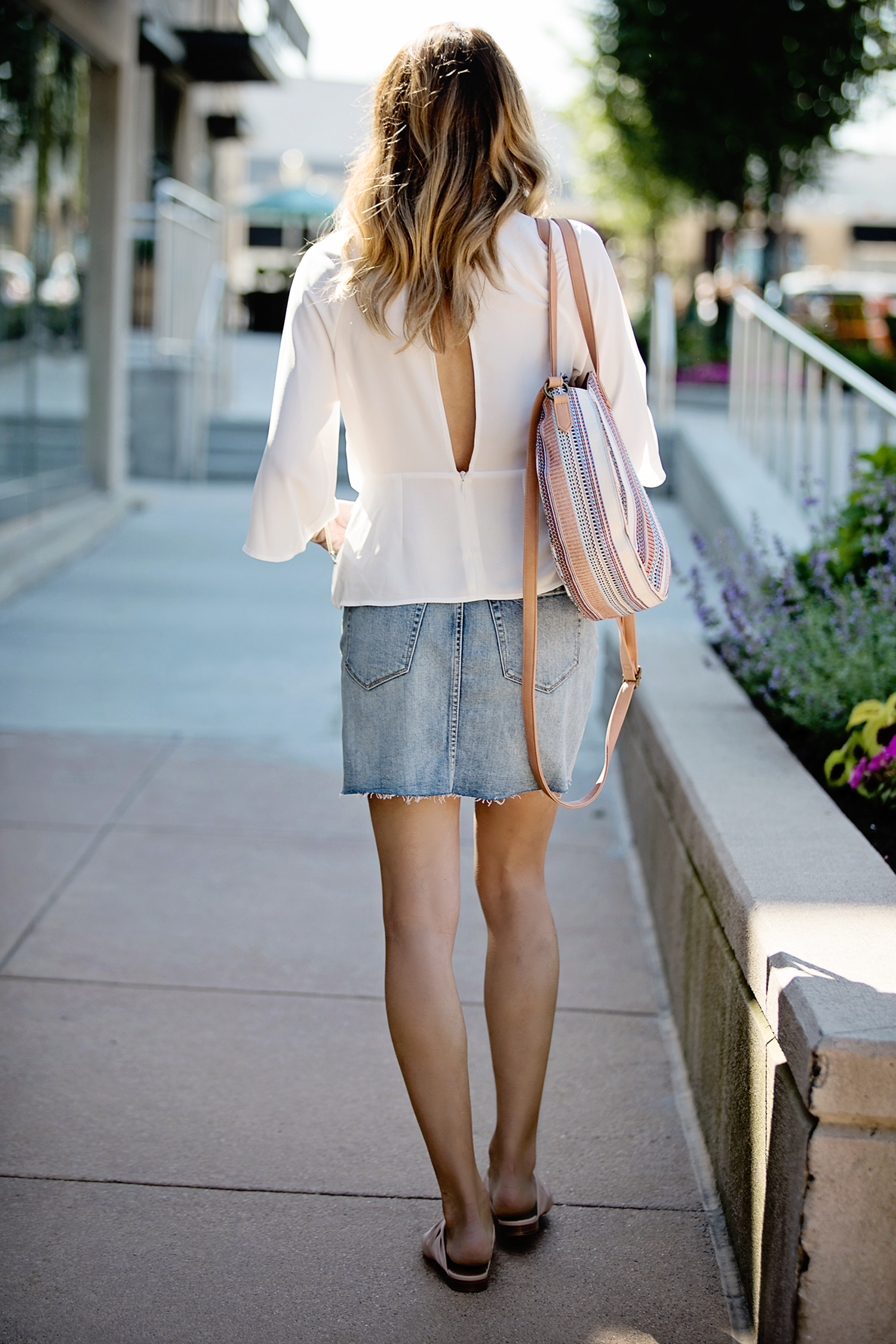 The Motherchic wearing topshop blouse and denim skirt