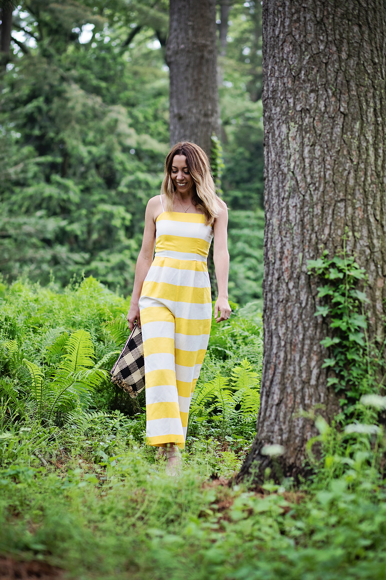 The Motherchic wearing striped jumpsuit