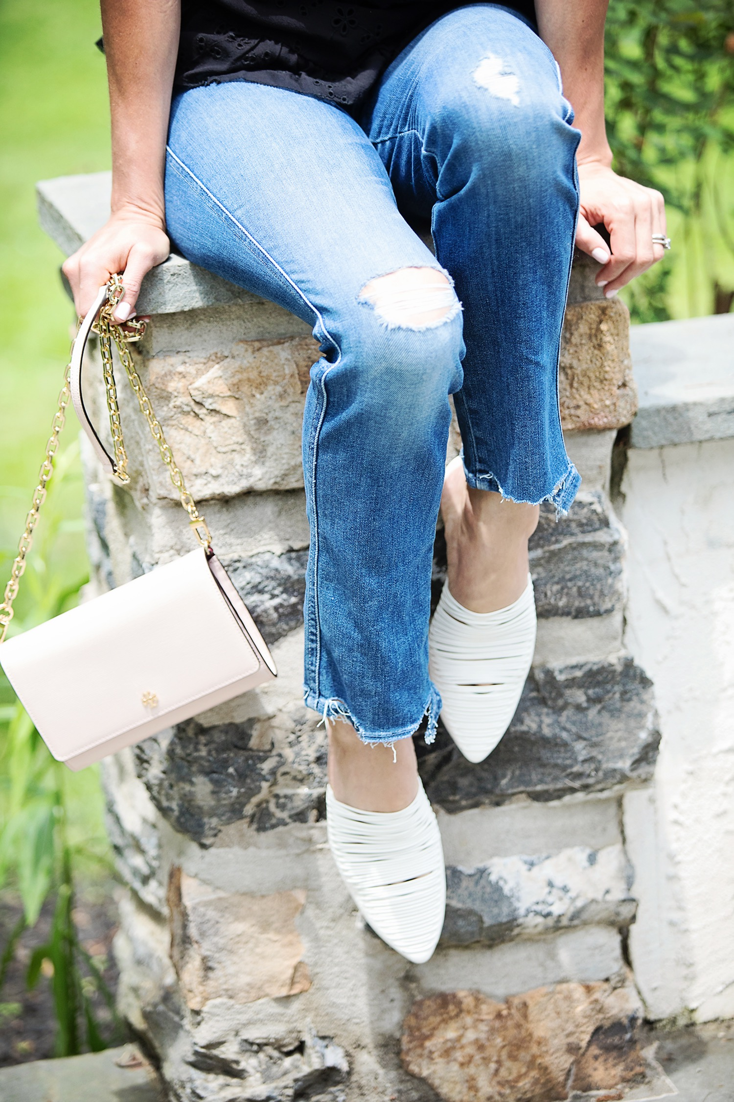 The Motherchic wearing tory burch mules and bag from Saks