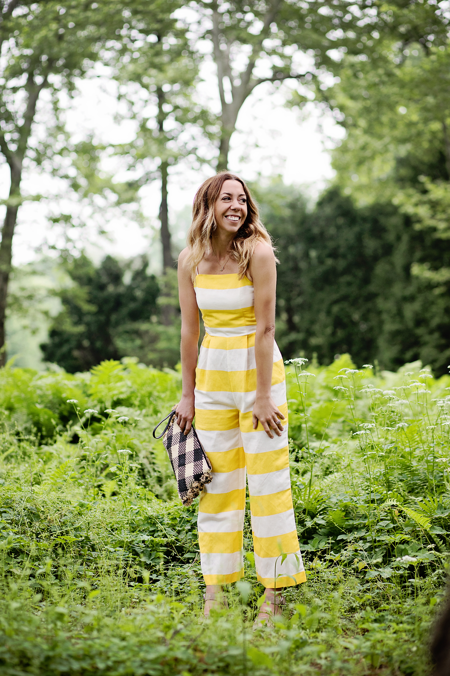 The motherchic wearing cece striped jumpsuit