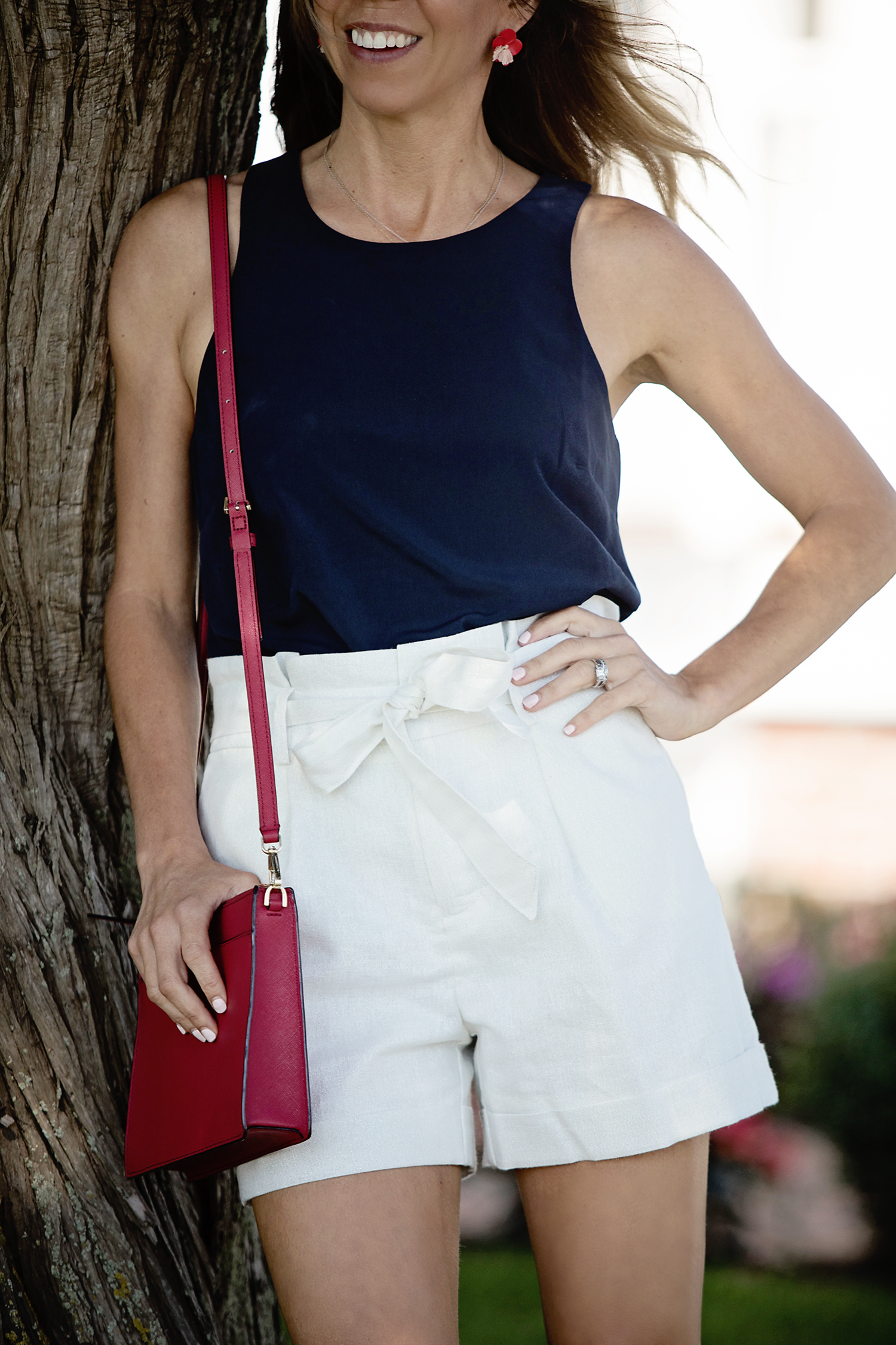The Motherchic wearing target shorts and banana republic tank